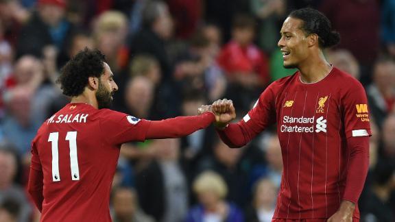 Mohamed Salah (L) celebrates with Liverpool's Dutch defender Virgil van Dijk after scoring the team's second goal against Norwich.