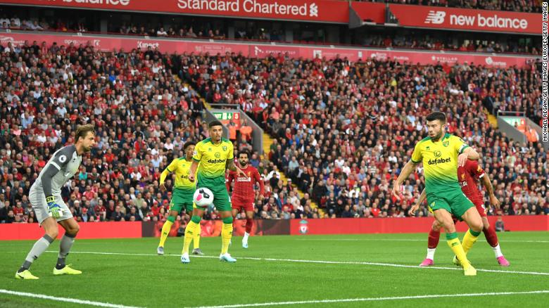 Grant Hanley scores an own goal during the season opener agaisnt Liverpool.