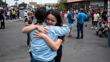 CNN reporter Nicole Chavez hugs Adria Gonzalez, a mass shooting survivor in El Paso, opposite Walmart where the shooting took place.