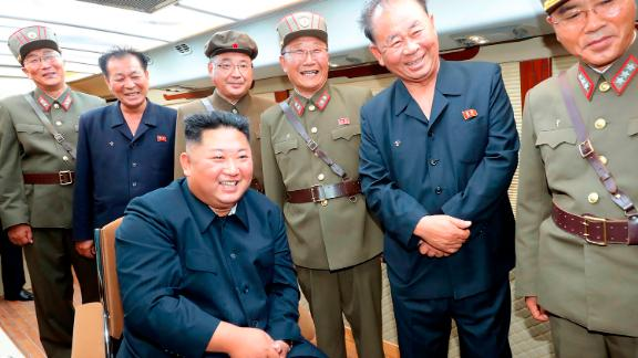 Kim Jong-un observes the test-firing of short-range weapons, in a photo released by North Korea