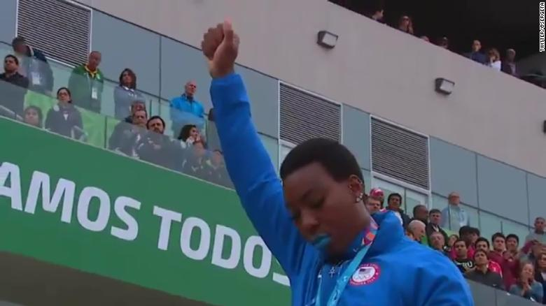 U.S. hammer thrower Gwen Berry raises her fist at the end of the national anthem at the Pan Am Games on Saturday.