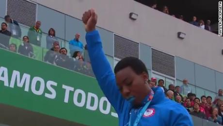 U.S. hammer thrower Gwen Berry raises her fist at the end of the national anthem at the Pan Am Games.