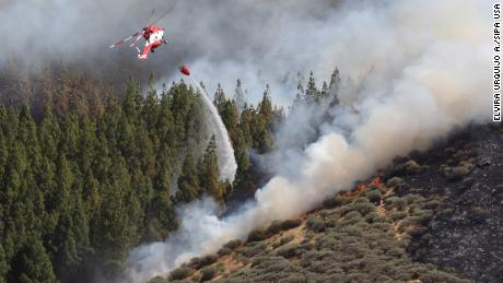 A helicopter helps fight a forest fire in Gran Canaria, Canary Islands, on August 10.