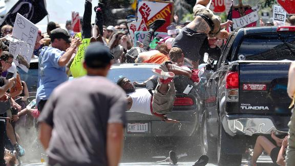 People fly into the air as a vehicle drives into a group of protesters demonstrating against a white nationalist rally in Charlottesville, Va., Saturday, Aug. 12, 2017. The nationalists were holding the rally to protest plans by the city of Charlottesville to remove a statue of Confederate Gen. Robert E. Lee. There were several hundred protesters marching in a long line when the car drove into a group of them.