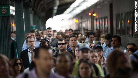 Passengers disembark from a New Jersey Transit train at the Hoboken terminal.