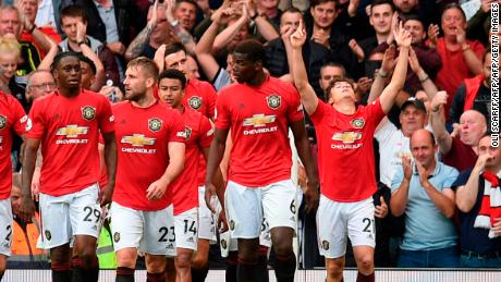 Manchester United's Daniel James (R) celebrates with teammates after scoring on his full Premier League debut against Chelsea.