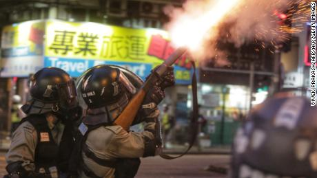 Riot police fire tear gas towards pro-democracy protesters during a stand-off in the Wan Chai district in Hong Kong on August 11, 2019.