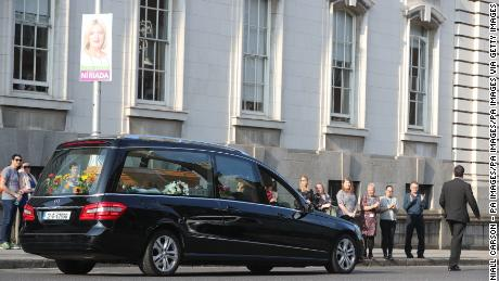 The hearse carrying the body of campaigner Emma Mhic Mhathuna, one of the most high-profile victims of Ireland's cervical smear test controversy, passes by government buildings last October.