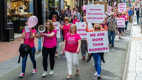 Demonstrators march in protest of the national cervical check screening program, which has been embroiled in a series of scandals for more than a year.