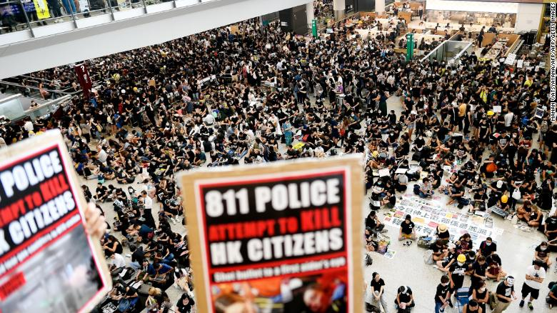 Pro-democracy protesters gather against the police brutality and the controversial extradition bill at Hong Kong's international airport on August 12, 2019.