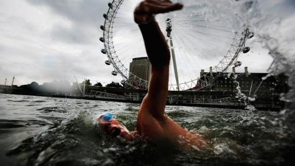 Endurance swimmer and conservationist Lewis Pugh swims in the Thames River in London.