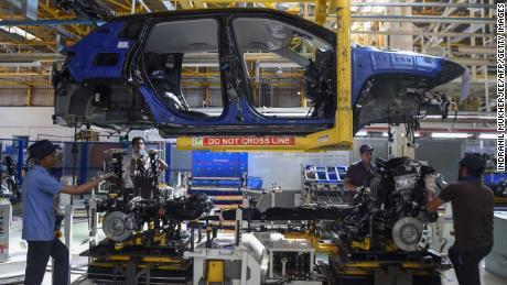 In this photograph taken on July 23, 2019 workers assemble a car at a FCA India Automobiles manufacturing facility in Ranjangaon, some 200km east of Mumbai. (Photo by Indranil MUKHERJEE / AFP)        (Photo credit should read INDRANIL MUKHERJEE/AFP/Getty Images)