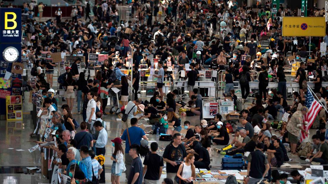 Hong Kong protesters attempt to restore peace after airport violence