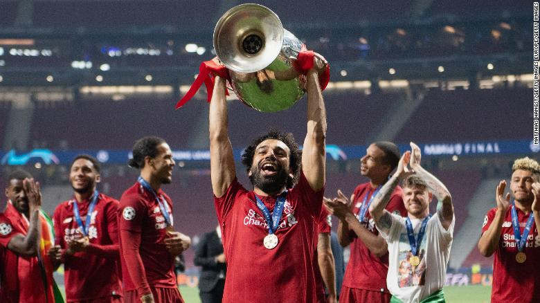 Mohamed Salah lifts the Champions League trophy in Madrid.