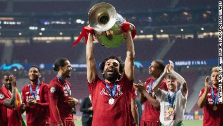 MADRID, SPAIN - JUNE 01: Mohamed Salah of Liverpool lifts the Champions League Trophy following the UEFA Champions League Final between Tottenham Hotspur and Liverpool at Estadio Wanda Metropolitano on June 01, 2019 in Madrid, Spain. (Photo by Matthias Hangst/Getty Images)