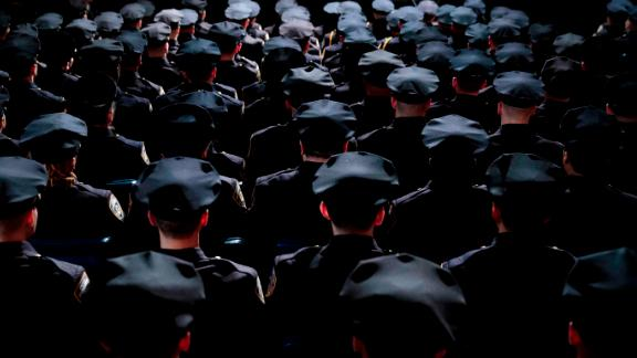 NEW YORK, NY - MARCH 30: The newest members  of the New York City Police Department (NYPD) attend their police academy graduation ceremony at the Theater at Madison Square Garden, March 30, 2017 in New York City. Over 600 new officers were sworn in during the ceremony. (Photo by Drew Angerer/Getty Images)