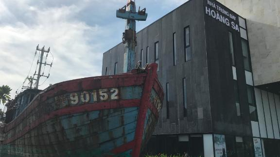 """Fishing vessel 90152 sits outside the Paracel Islands Museum in Da Nang, Vietnam. The ship was sunk in a skirmish with China in 2014, recovered by Vietnam, and sits outside the museum as """"evidence of accusations of China"""