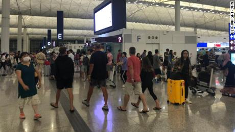 Order returns to Hong Kong airport, but tensions hanging