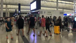 Order returns to Hong Kong airport, but tensions linger