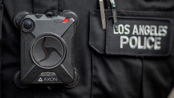 """A Los Angeles police officer wears an Axon body camera in 2017. Axon said earlier this year that it would not install facial-recognition technology in its body cameras, stating it's """"not currently reliable enough."""" (Photo by David McNew/Getty Images)"""