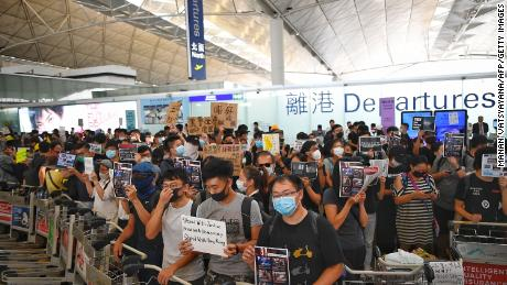Protesters block the departure gates on Tuesday.