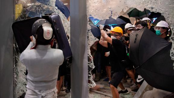 Protesters shatter glass to get inside the Hong Kong's legislature building during a demonstration on July 1, 2019.