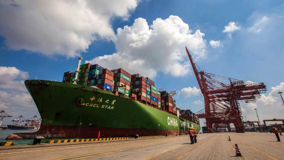 This photo taken on August 6, 2019 shows a cargo ship berthing at Qingdao port in Qingdao in China's eastern Shandong province. - China's good shipments abroad beat expectations to rise in July while its purchases continued to shrink, official data showed on August 8. (Photo by STR / AFP) / China OUT        (Photo credit should read STR/AFP/Getty Images)
