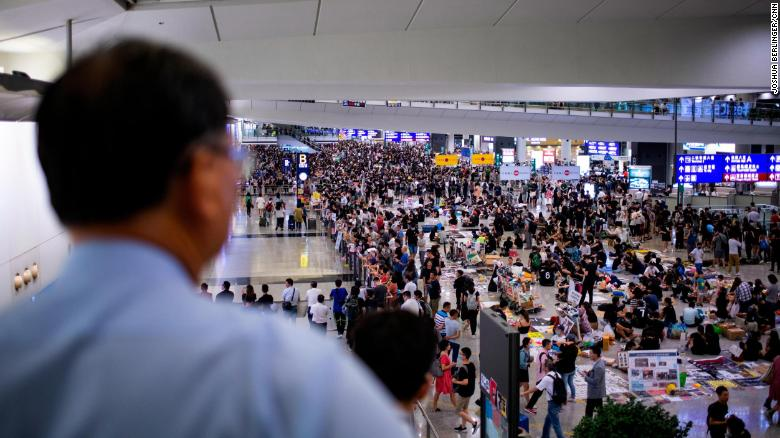 Protesters seen at the arrivals hall of Hong Kong International Airport on Tuesday evening.