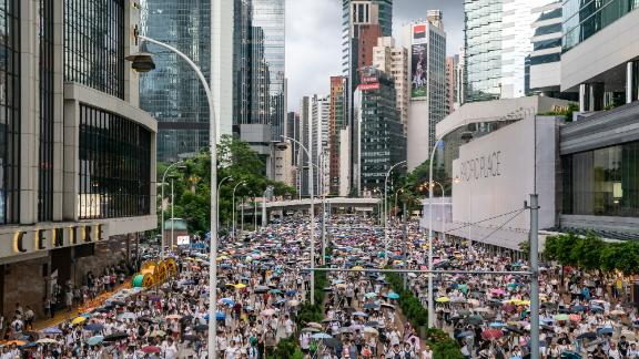 Protesters march on a street during a rally against a controversial extradition law proposal on June 9, 2019.