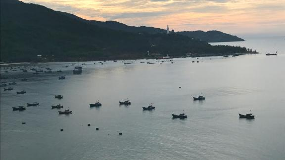 Vietnamese fishing boat are anchored off the beach in Da Nang, Vietnam, just across the highway from the Paracel Islands Museum.