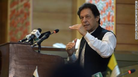 Pakistan's Prime Minister Imran Khan addresses the legislative assembly in Muzaffarabad, the capital of Pakistan-controlled Kashmir on August 14, 2019, to mark the country's Independence Day. - His visit to mark the country's Independence Day comes more than a week after Indian Prime Minister Narendra Modi delivered a surprise executive decree to strip its portion of the Muslim-majority Himalayan region of its special status. (Photo by AAMIR QURESHI / AFP)        (Photo credit should read AAMIR QURESHI/AFP/Getty Images)