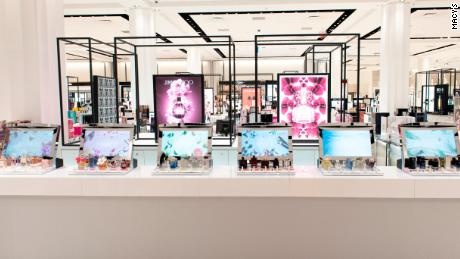 """Macy's new """"digital fragrance bar."""" Customers pick up a perfume and a touch screen lights up with information about the scent."""