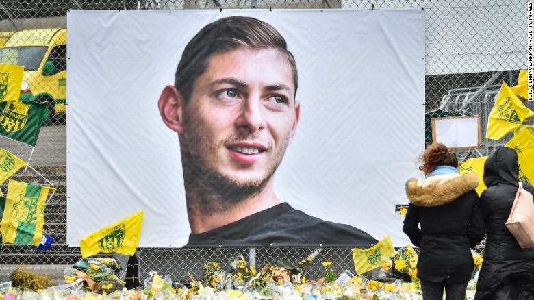 Yellow flowers are displayed in front of the portrait of  Emiliano Sala at the Beauvoir stadium in Nantes, France, in February 2019.