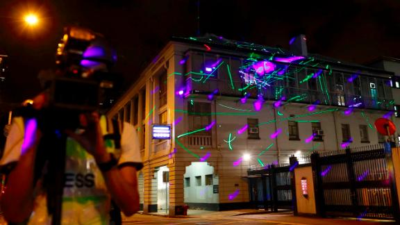 Protesters point lasers at the Sham Shui Po police station on August 14.