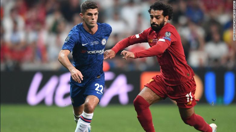 Pulisic battles for the ball with Liverpool's Mohamed Salah during the UEFA Super Cup.