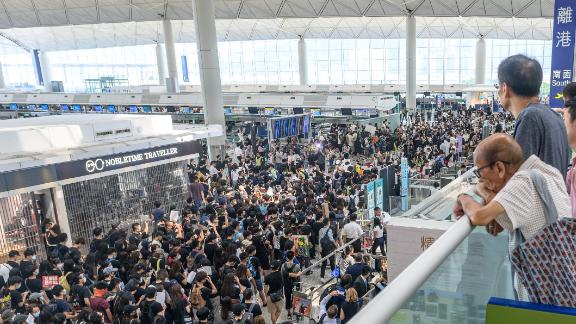 Hong Kong pro-democracy protesters crowd the area in front of the departure gates to block access at Hong Kong International Airport on August 13, 2019.