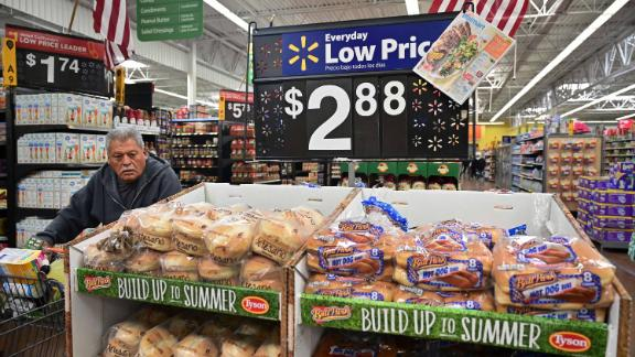 A man pushes his shopping cart past bread for sale at a Walmart Supercenter store in Rosemead, California on May 23, 2019. - Walmart has said it will raise prices as a result of the Trump administration's tariffs on Chinese-made goods as the trade war is about to take a bite into the retail sector affecting consumers shopping at stores like Walmart, Target and Macy's. (Photo by Frederic J. BROWN / AFP)        (Photo credit should read FREDERIC J. BROWN/AFP/Getty Images)