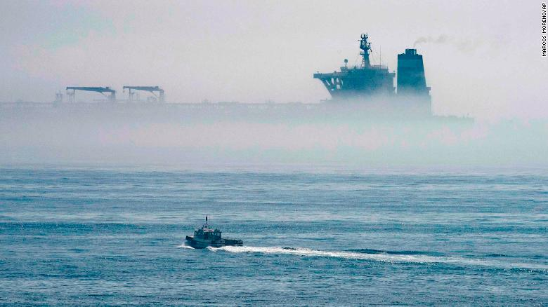 The Grace 1 supertanker looms among the sea fog off the coast of Gibraltar.
