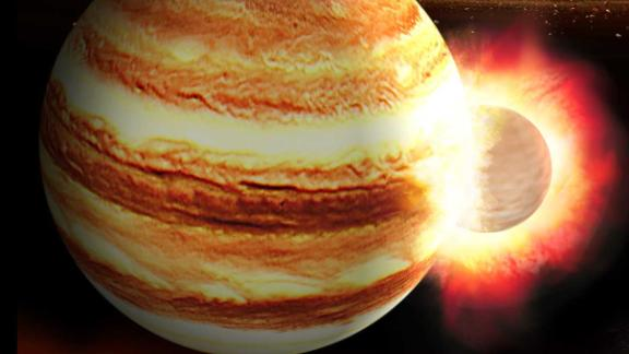 An artist's impression of a collision between a young Jupiter and a massive, still-forming protoplanet in the early solar system.