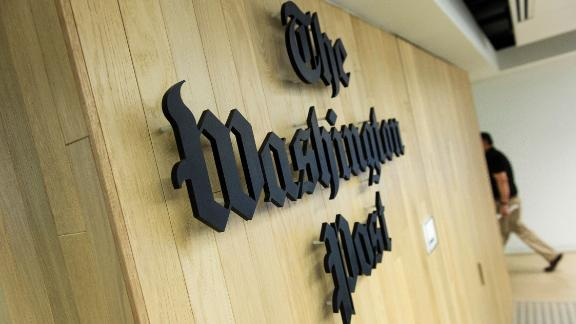 A man walks through the newsroom in the Washington Post