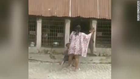 This grab from a video circulated on social media shows a Nigerian woman who has been arrested after she was filmed beating and locking a boy in dog cage.