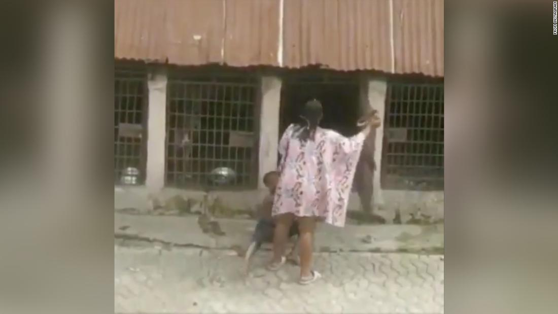 A Nigerian woman was arrested after beating a boy and locking him in a dog cage