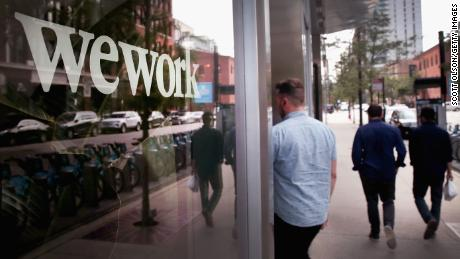 CHICAGO, ILLINOIS - AUGUST 14:  A sign marks the location of a WeWork office facility on August 14, 2019 in Chicago, Illinois. WeWork, a real estate firm that leases shared office space, announced today that it had filed a financial prospectus with regulators to become a publicly traded company. (Photo by Scott Olson/Getty Images)