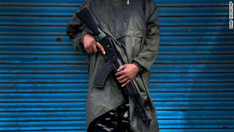 An Indian paramilitary soldier stands guard during security lockdown in Srinagar, Indian controlled Kashmir, Wednesday, Aug. 14, 2019. India has maintained an unprecedented security lockdown to try to stave off a violent reaction to Kashmir's downgraded status. Protests and clashes have occurred daily, thought the curfew and communications blackout have meant the reaction is largely subdued. (AP Photo/ Dar Yasin)