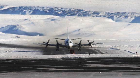PITUFFIK, GREENLAND - MARCH 24:  NASA's Operation IceBridge research aircraft taxis after landing at Thule Air Base on March 24, 2017 in Pituffik, Greenland. NASA's Operation IceBridge is flying research missions out of Thule Air Base and other Arctic locations during their annual Arctic spring campaign. Thule Air Base is the U.S. military's northernmost base located some 750 miles above the Arctic Circle. NASA's Operation IceBridge has been studying how polar ice has evolved over the past nine years and is currently flying a set of eight-hour research flights over ice sheets and the Arctic Ocean to monitor Arctic ice loss aboard a retrofitted 1966 Lockheed P-3 aircraft. According to NASA scientists and the National Snow and Ice Data Center (NSIDC), sea ice in the Arctic appears to have reached its lowest maximum wintertime extent ever recorded on March 7. Scientists have said the Arctic has been one of the regions hardest hit by climate change.  (Photo by Mario Tama/Getty Images)