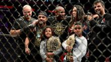 Cormier celebrates with his family and team after his win by submission over Derrick Lewis in 2018.
