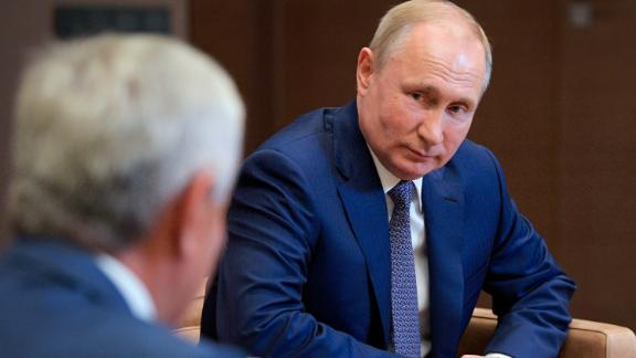 Russian President Vladimir Putin, right, listens to Raul Khadzhimba, leader of Georgia