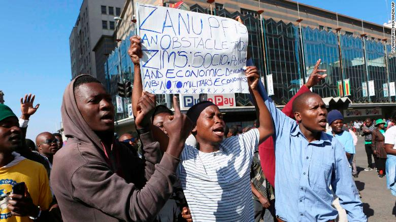 MDC protestors defy the ban against a planned demonstration against President Mnangagwa's government in Harare on Friday.