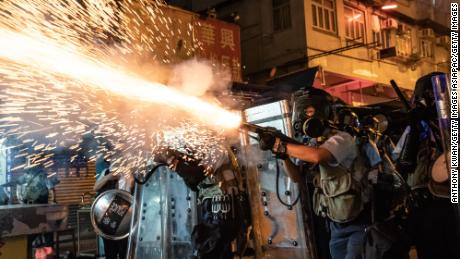 Police fire tear gas to clear pro-democracy protesters during a demonstration on Hungry Ghost Festival day in the Sham Shui Po district on August 14, 2019 in Hong Kong.