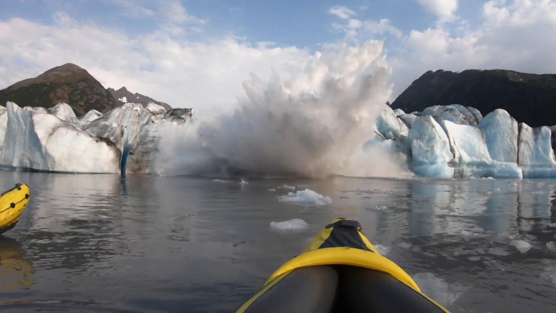 Watch a giant glacier collapse in front of two kayakers